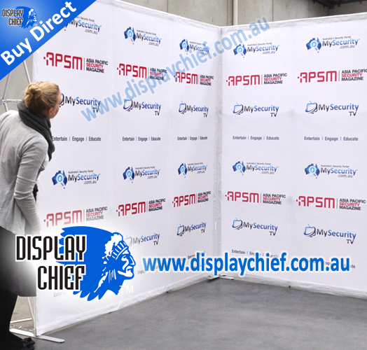 Person looking around at the corner of the free standing display sign with printed graphics for Asia Pacific Security Magazine display exhibition