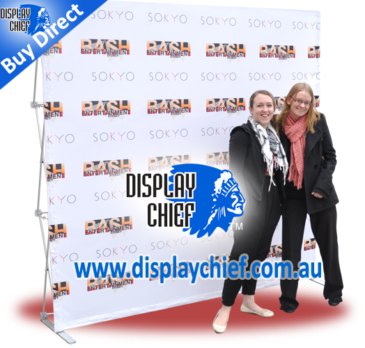 Pop up display Ladies on red carpet having photo taken infront of portable step repeat sign banner backdrop for bash entertainment sokyo Sydney